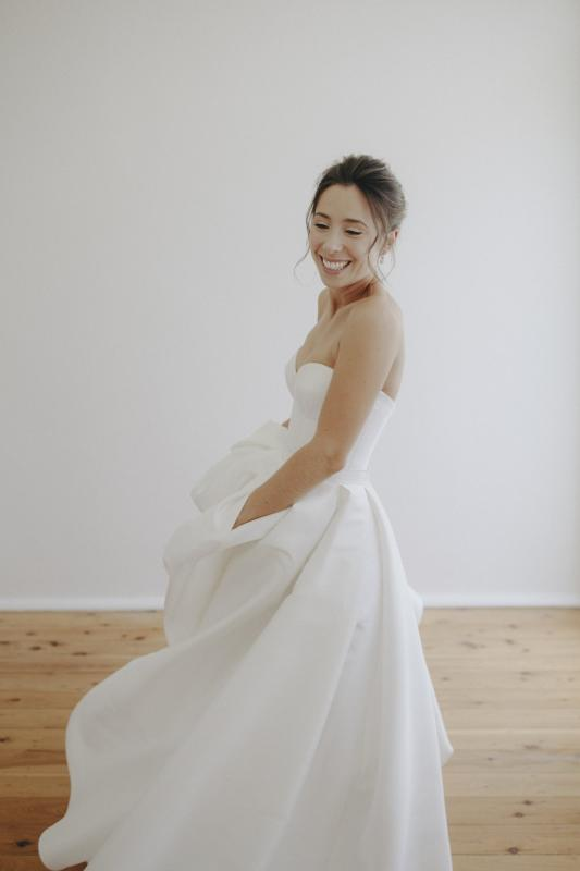 Real bride Tori wore the Bespoke Blake-Melanie gown by Karen Willis Holmes.