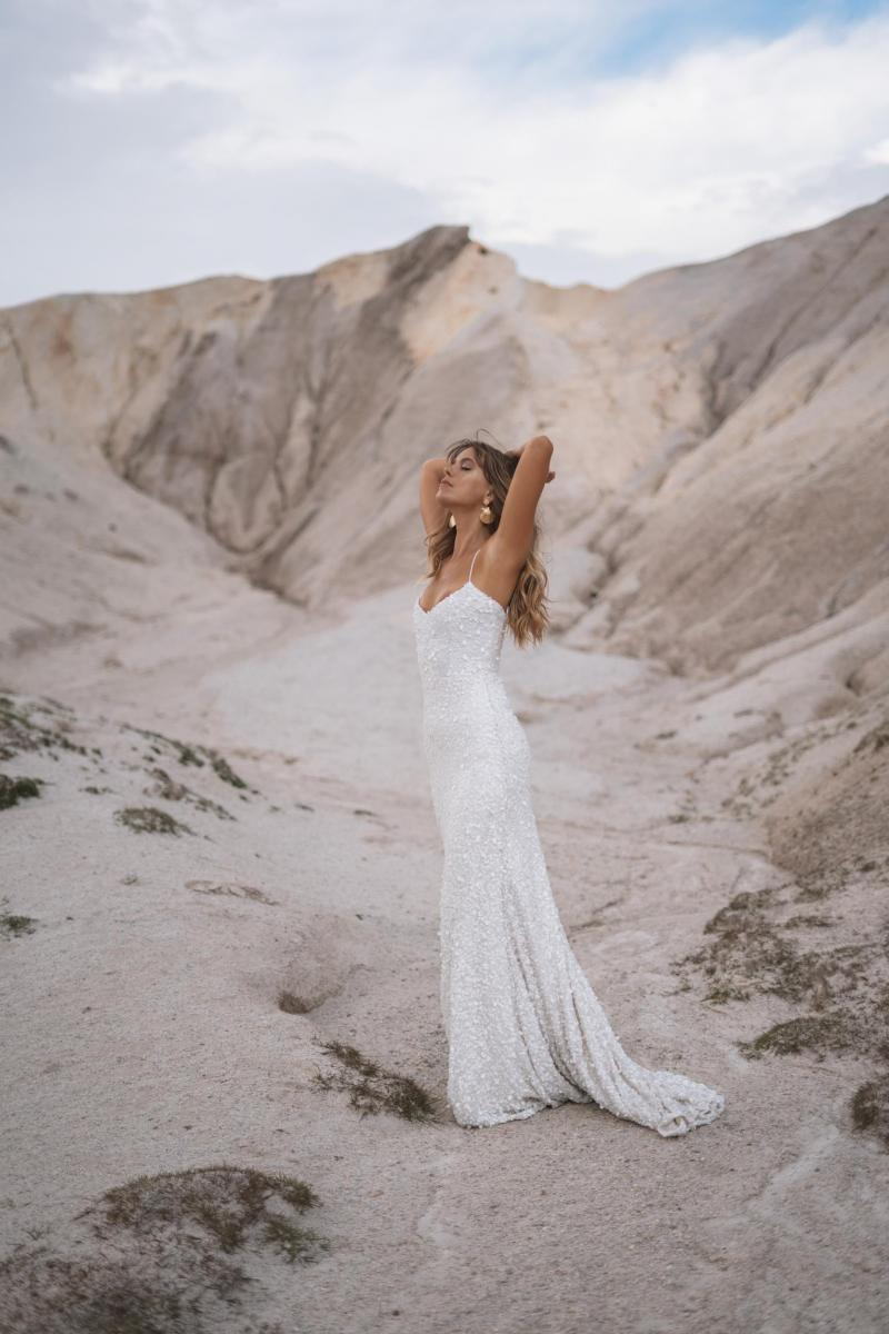 The Anya gown by Karen Willis Holmes, fit and flare v-neck beaded wedding dress.