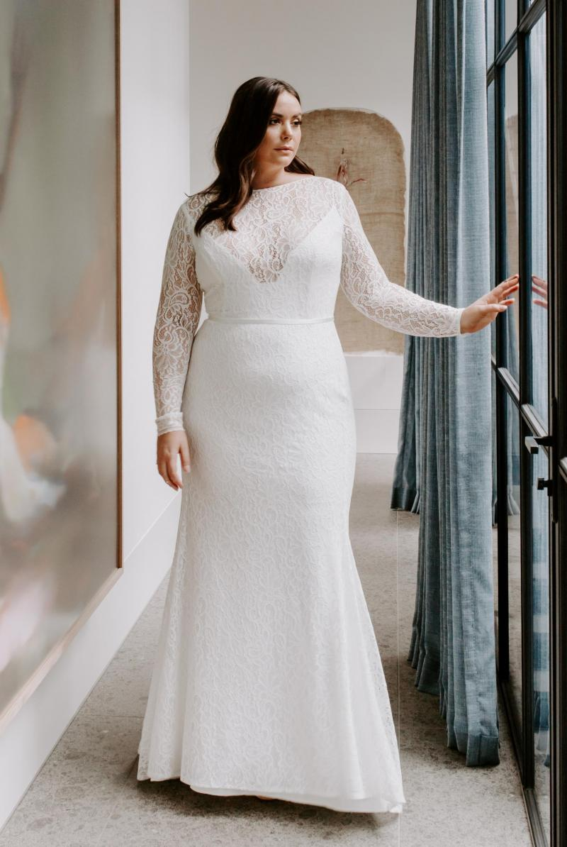 The Karina Curve gown by Karen Willis Holmes, long sleeve curve lace wedding dress.