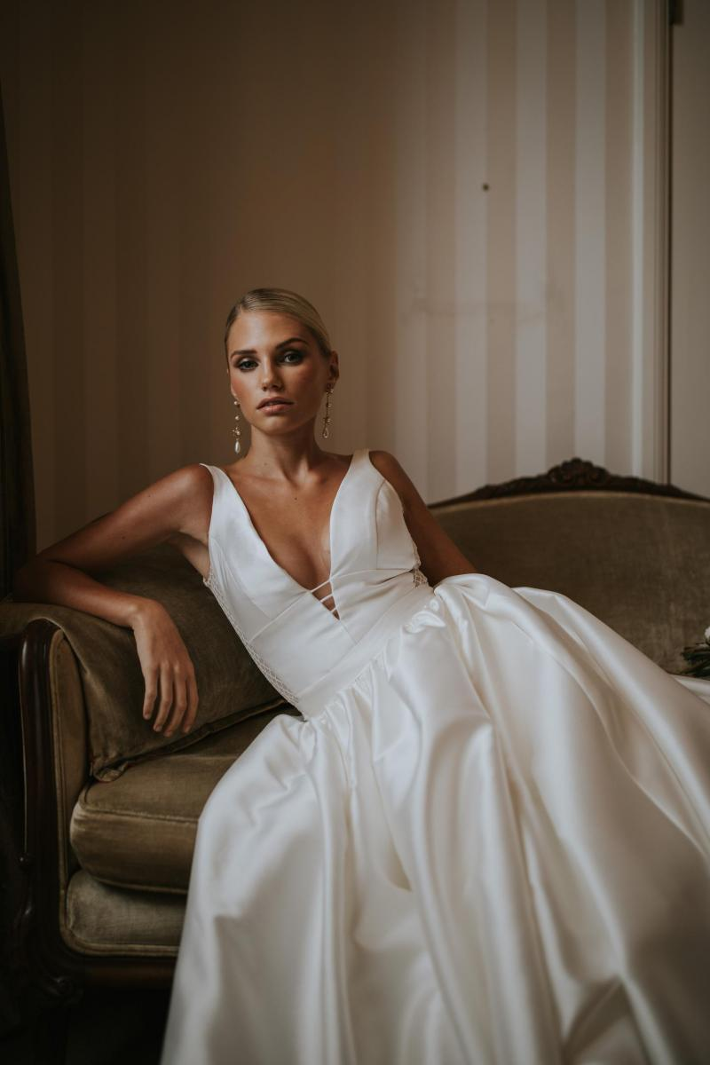 The Shelly Julianne gown by Karen Willis Holmes, plunging neckline v-neck simple ball gown wedding dress with pockets.