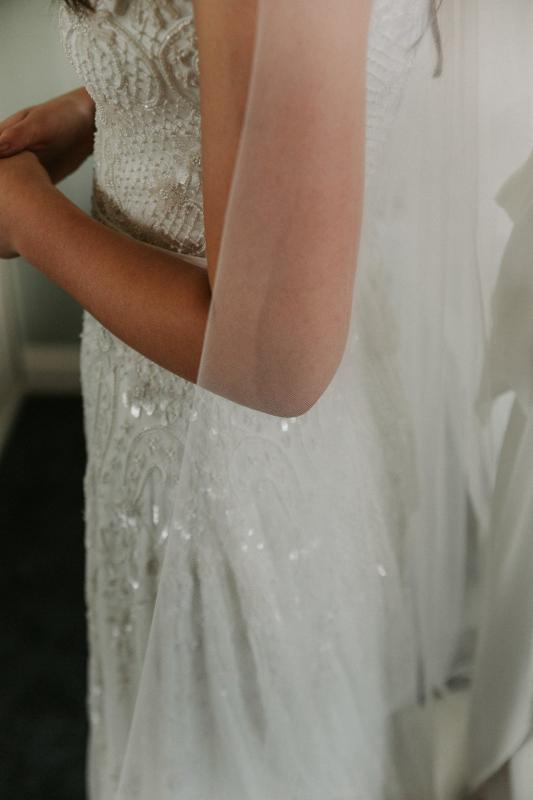 Real bride Lara wore the Luxe Beatrice wedding dress by Karen Willis Holmes.