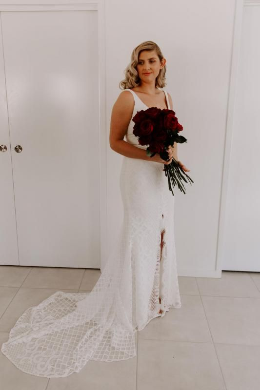 Real bride Amberrose wore the Wild Hearts Bobby wedding dress by Karen Willis Holmes.