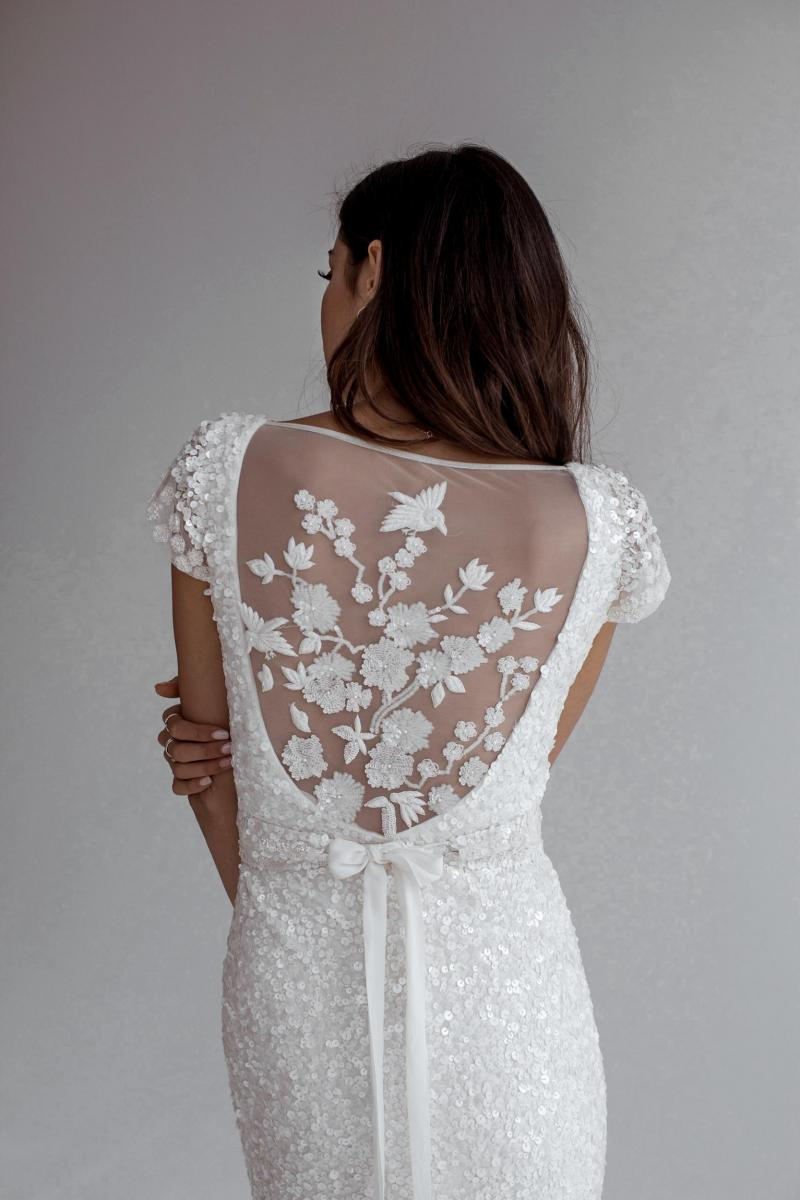 The Caitlyn gown by Karen Willis Holmes, cap sleeve fit and flare beaded wedding dress.