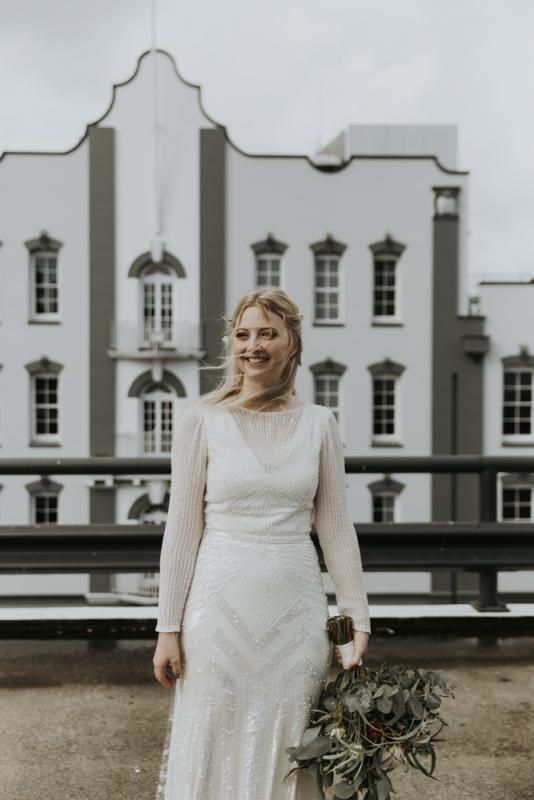 Real bride Hannah wore the Luxe Cassie wedding dress by Karen Willis Holmes.