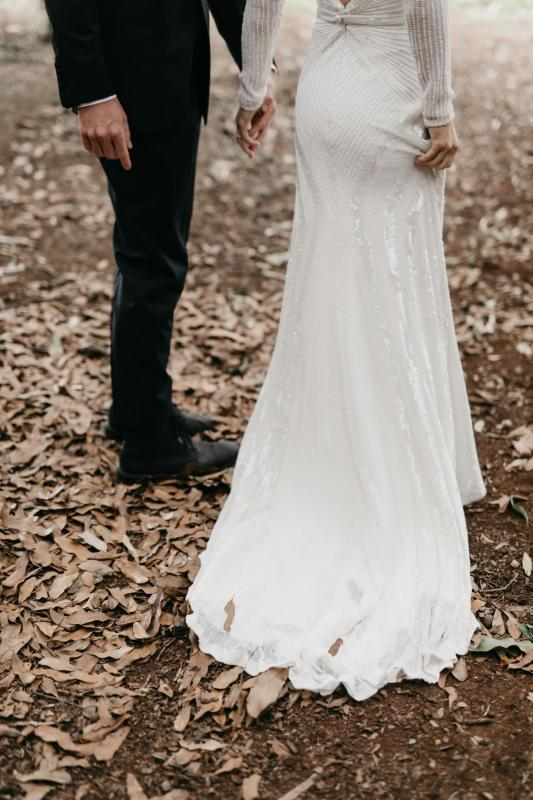 Real bride Taylor wore the Luxe Cassie wedding dress by Karen Willis Holmes.