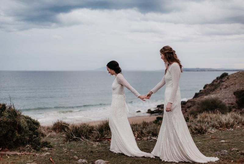 Real brides Elle & Carina wore the Luxe Celine & Cassie wedding dresses by Karen Willis Holmes.