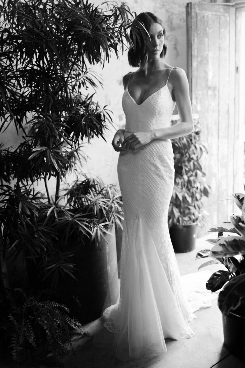 The Elodie gown by Karen Willis Holmes, a simple lace v-neck wedding dress.