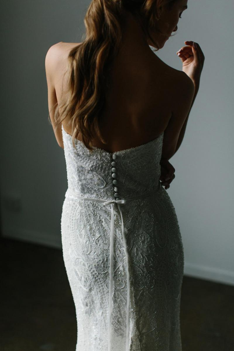 The Carrie gown by Karen Willis Holmes, backless beaded fit and flare wedding dress.