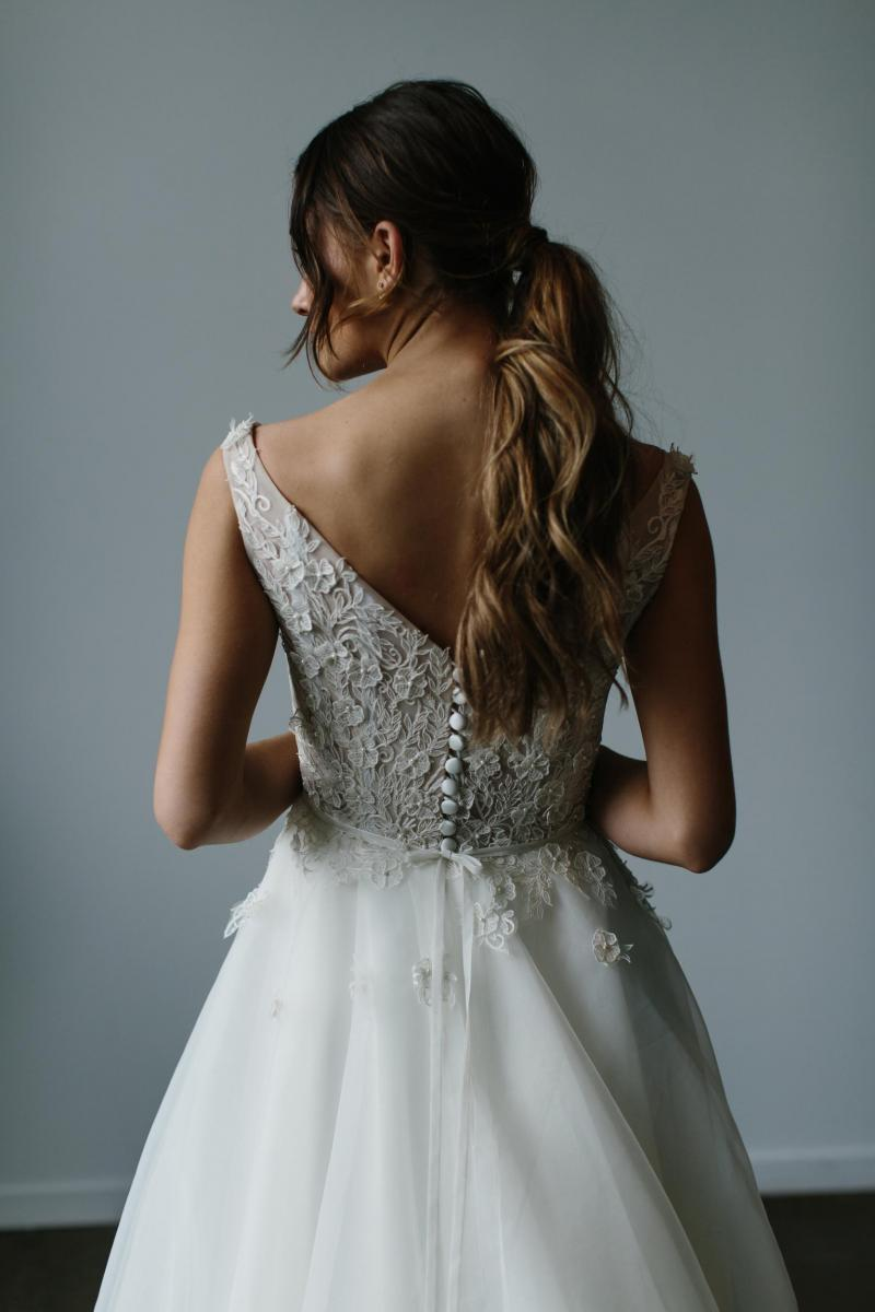 The Lydia gown by Karen Willis Holmes, blush open back a-line lace appliqué wedding dress.