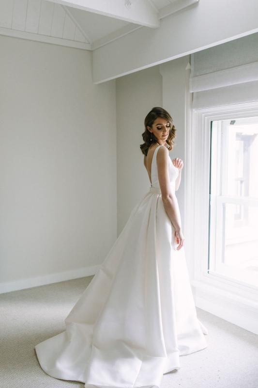 Real bride Courtney wore the Bespoke Leonie/Camille wedding dress by Karen Willis Holmes.