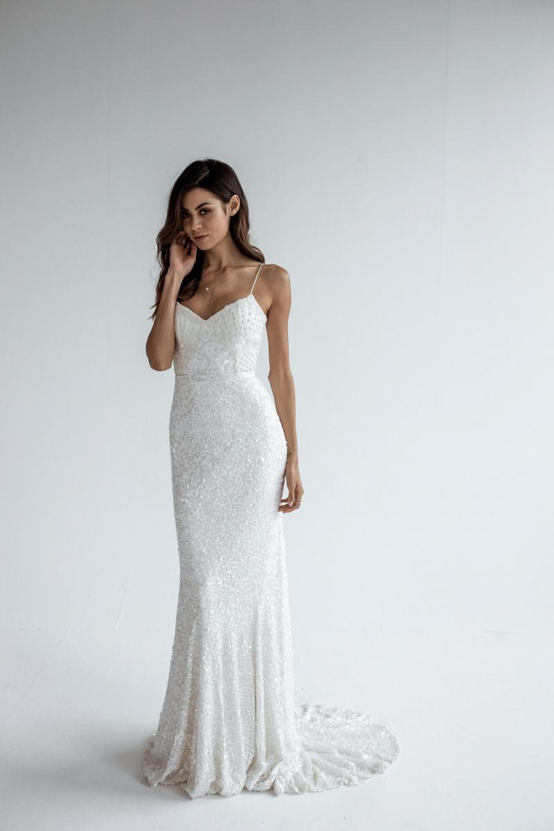 The Lottie gown by Karen Willis Holmes, sexy fit and flare beaded wedding dress.