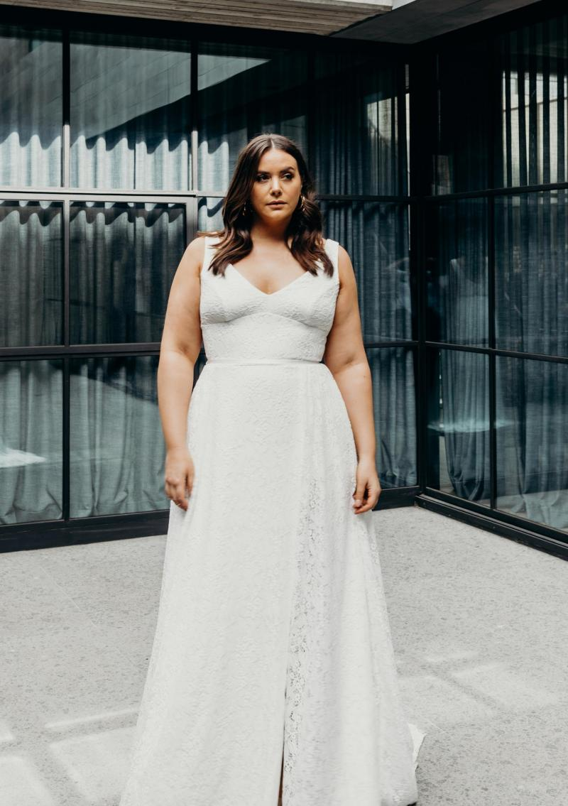 The Nadia Curve gown by Karen Willis Holmes, plus size a-line lace wedding dress with slit.