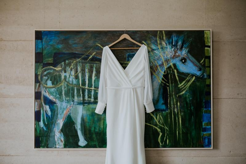 Real bride Maddy wore the Wild Hearts Nikki wedding dress by Karen Willis Holmes.