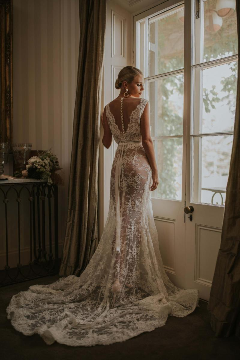 The Rosemary gown by Karen Willis Holmes, cap sleeve lace wedding dress with buttons down the back.
