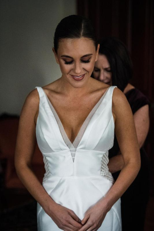 Real bride Caitlin wore the Bespoke Shelly/Samantha wedding dress by Karen Willis Holmes.