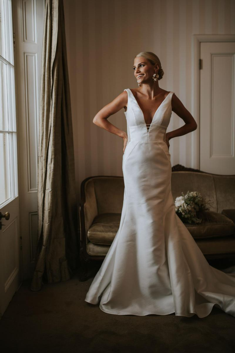 The Shelly Samantha gown by Karen Willis Holmes, modern simple plunging v-neck wedding dress.