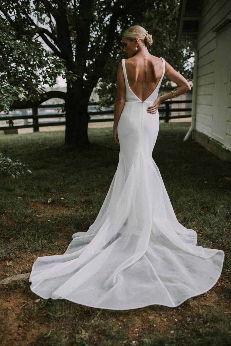 The Tatiana gown by Karen Willis Holmes, open back simple mermaid wedding dress.