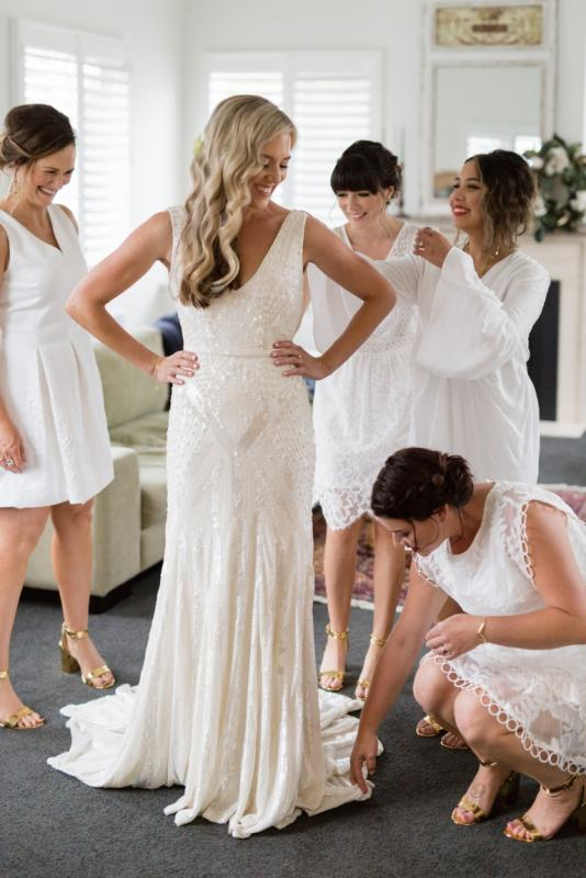 Real bride Karli wore the Luxe Fontanne wedding dress by Karen Willis Holmes.