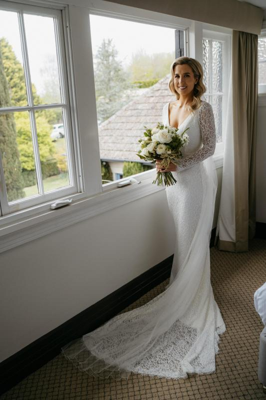 Real bride Hayley wore the Wild Hearts Valencia wedding dress by Karen Willis Holmes.