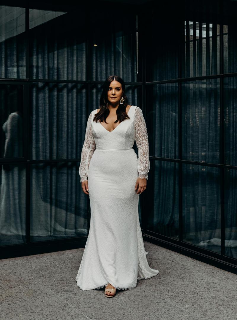 The Valencia Curve gown by Karen Willis Holmes, long sleeve fit and flare plus size lace wedding dress.