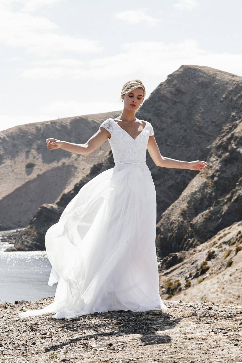 The Valeria gown by Karen Willis Holmes, a-line cap sleeve beaded wedding dress.