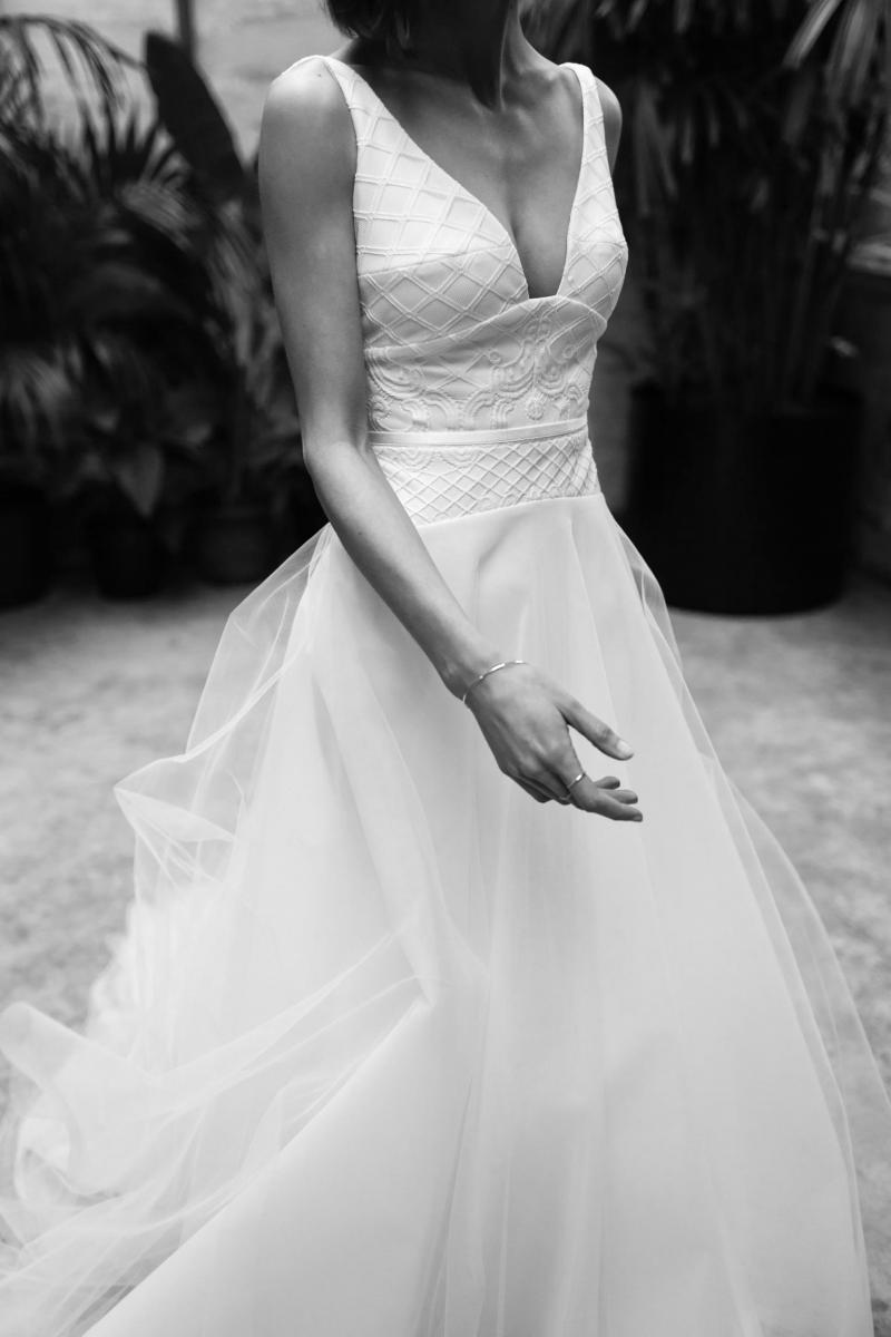 The Gaby gown by Karen Willis Holmes, a drop waist A-line lace wedding dress with tulle skirt.