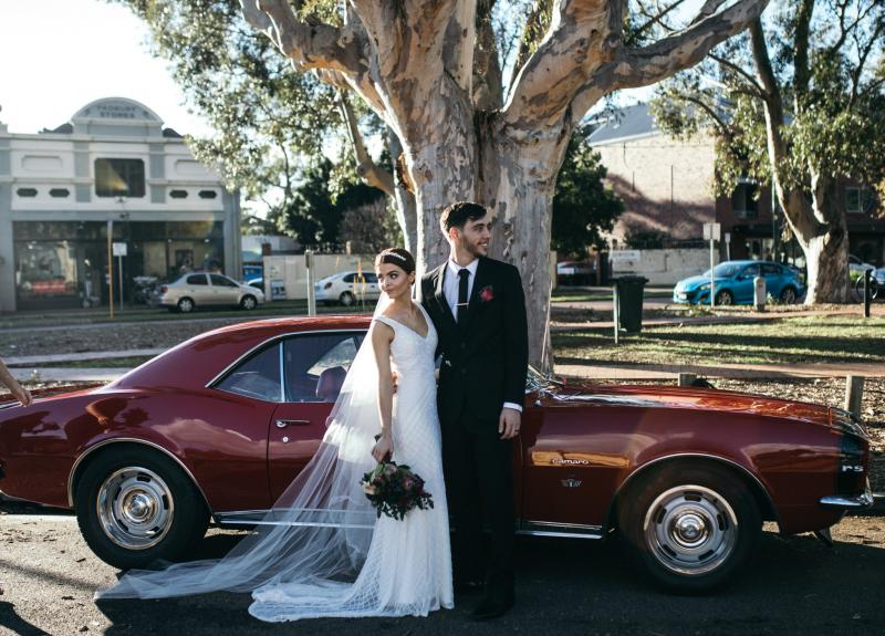 Real bride Victoria wore the Luxe Whitney wedding dress by Karen Willis Holmes.