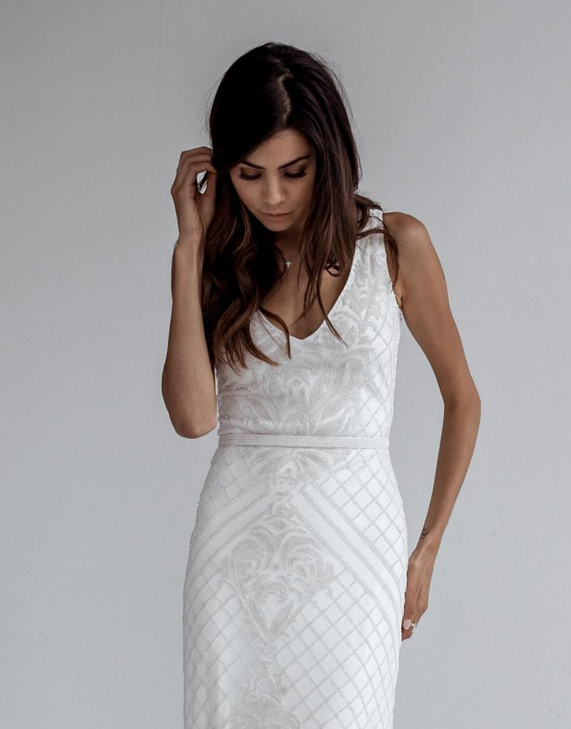 The Whitney by Karen Willis Holmes, v-neck fit and flare sequin wedding dress.