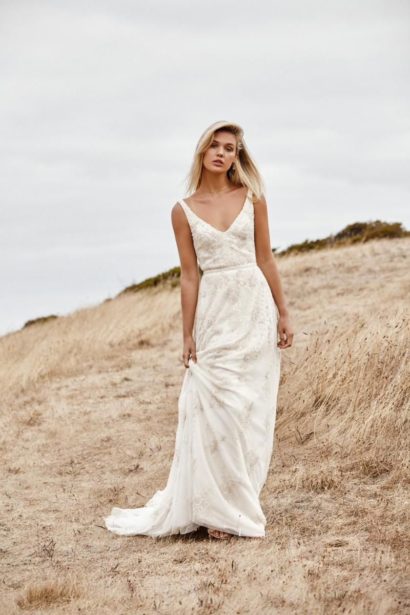 The Beatrice gown by Karen Willis Holmes, sheath beaded wedding dress.