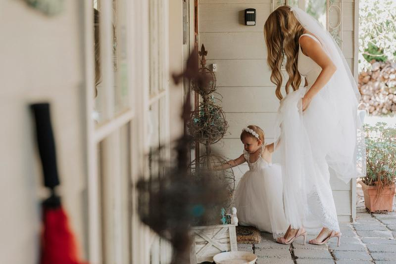 Real bride Casey wore the Wild Hearts Adina wedding dress by Karen Willis Holmes.