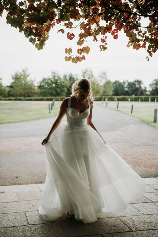 Real bride Peta wore the Bespoke Blake/Miley wedding dress by Karen Willis Holmes.