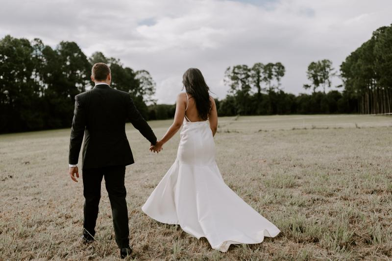 Real bride Bianca wore the Bespoke Jessie/Catriona wedding dress by Karen Willis Holmes.