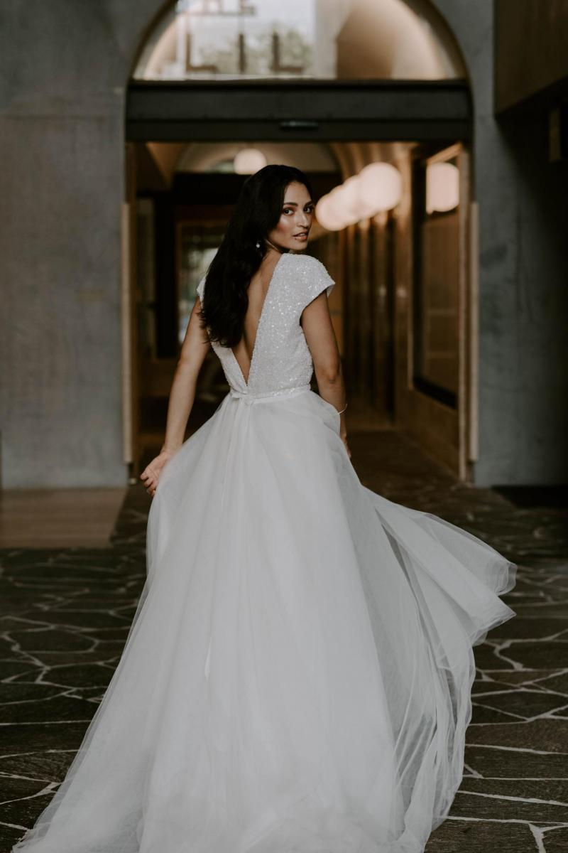 The Annette gown by Karen Willis Holmes, open back beaded wedding dress.