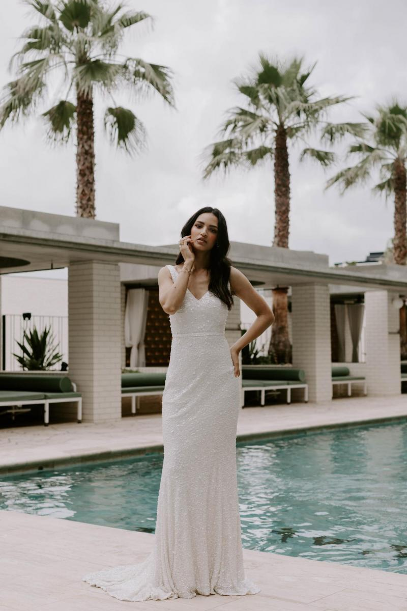 The Lola gown by Karen Willis Holmes, v-neck beaded fit and flare wedding dress.