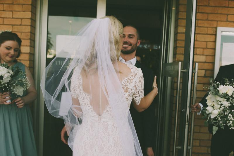 Real bride Sarah wore the Wild Hearts Aisling wedding dress by Karen Willis Holmes.