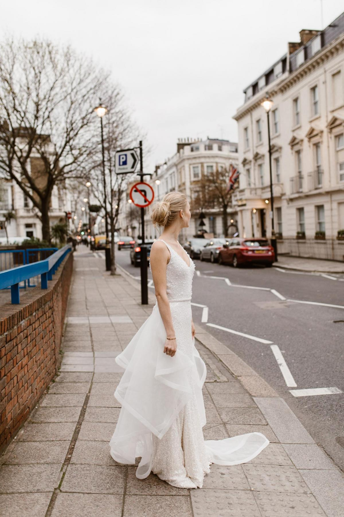 The Lola gown by Karen Willis Holmes, v-neck beaded wedding dress shown with detachable train.