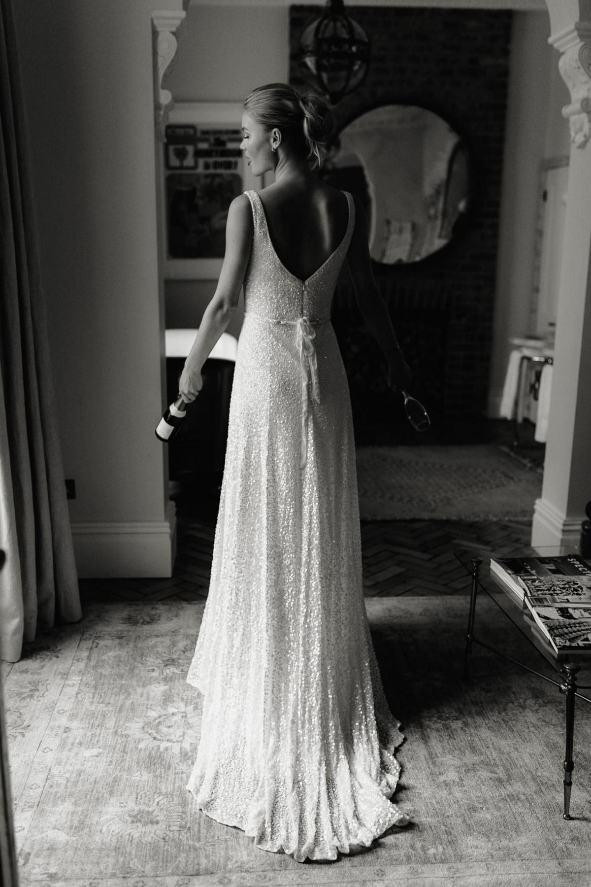 The Lotus gown by Karen Willis Holmes, open back a-line wedding dress with beading.