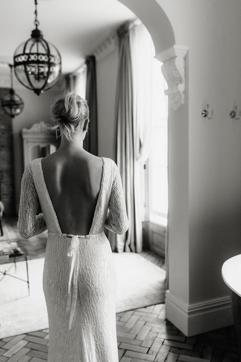 The Margareta gown by Karen Willis Holmes, backless beaded wedding dress.