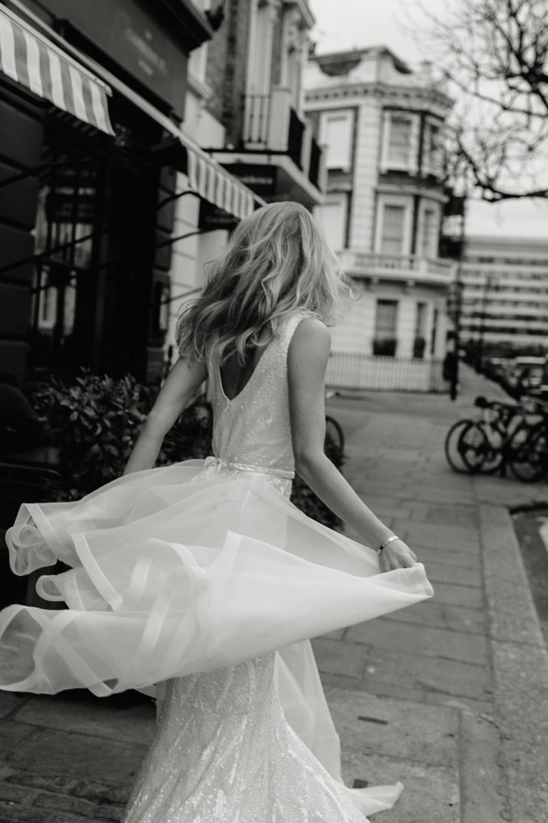 The Rhiannon gown by Karen Willis Holmes, open back fit and flare wedding dress shown with detachable train.