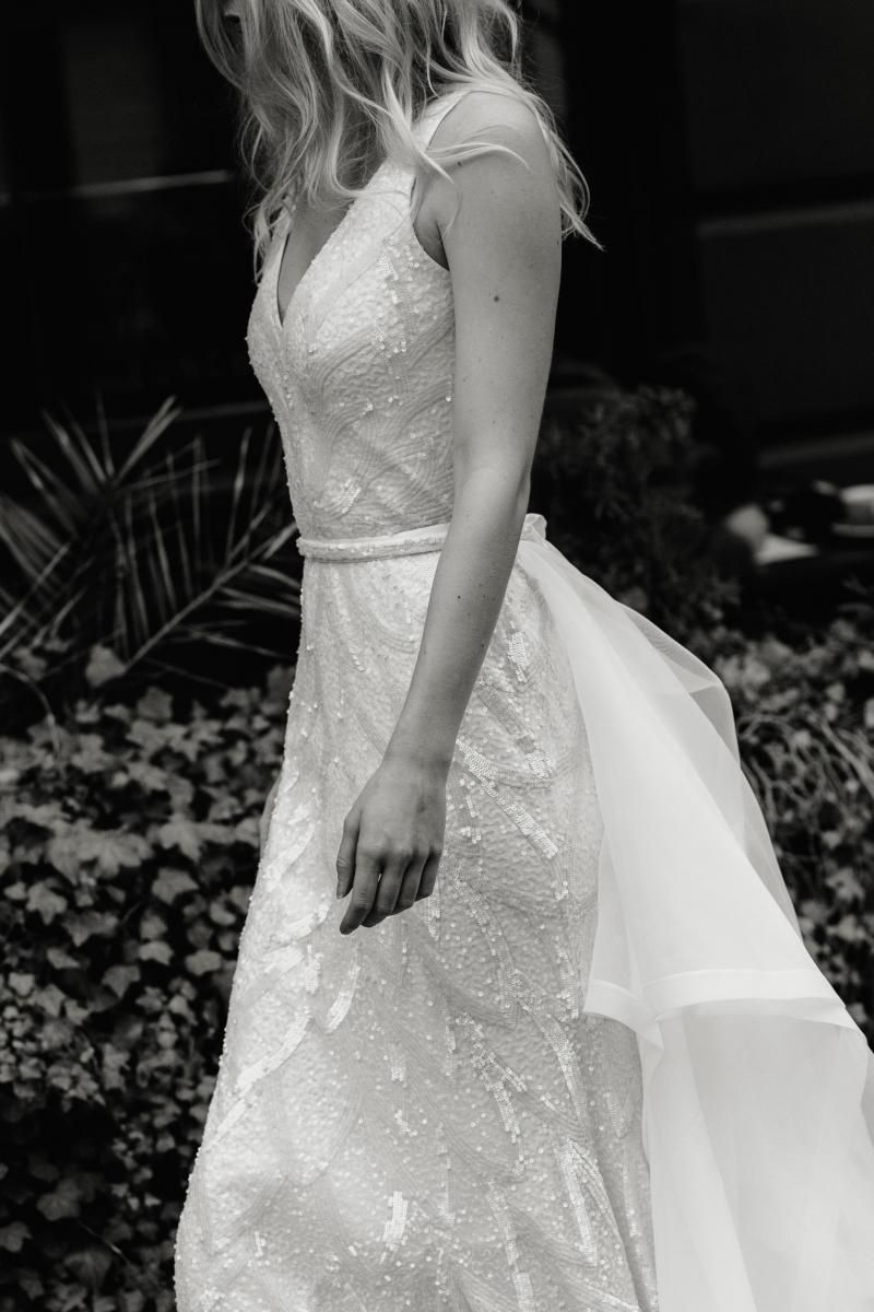 The Rhiannon gown by Karen Willis Holmes, fit and flare v-neck wedding dress shown with detachable train.