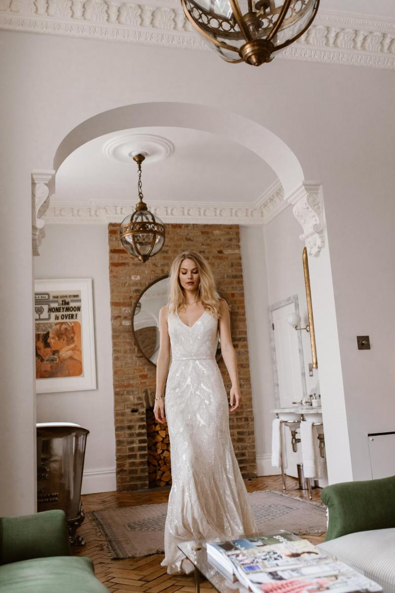 The Rhiannon gown by Karen Willis Holmes, fit and flare sequin wedding dress.