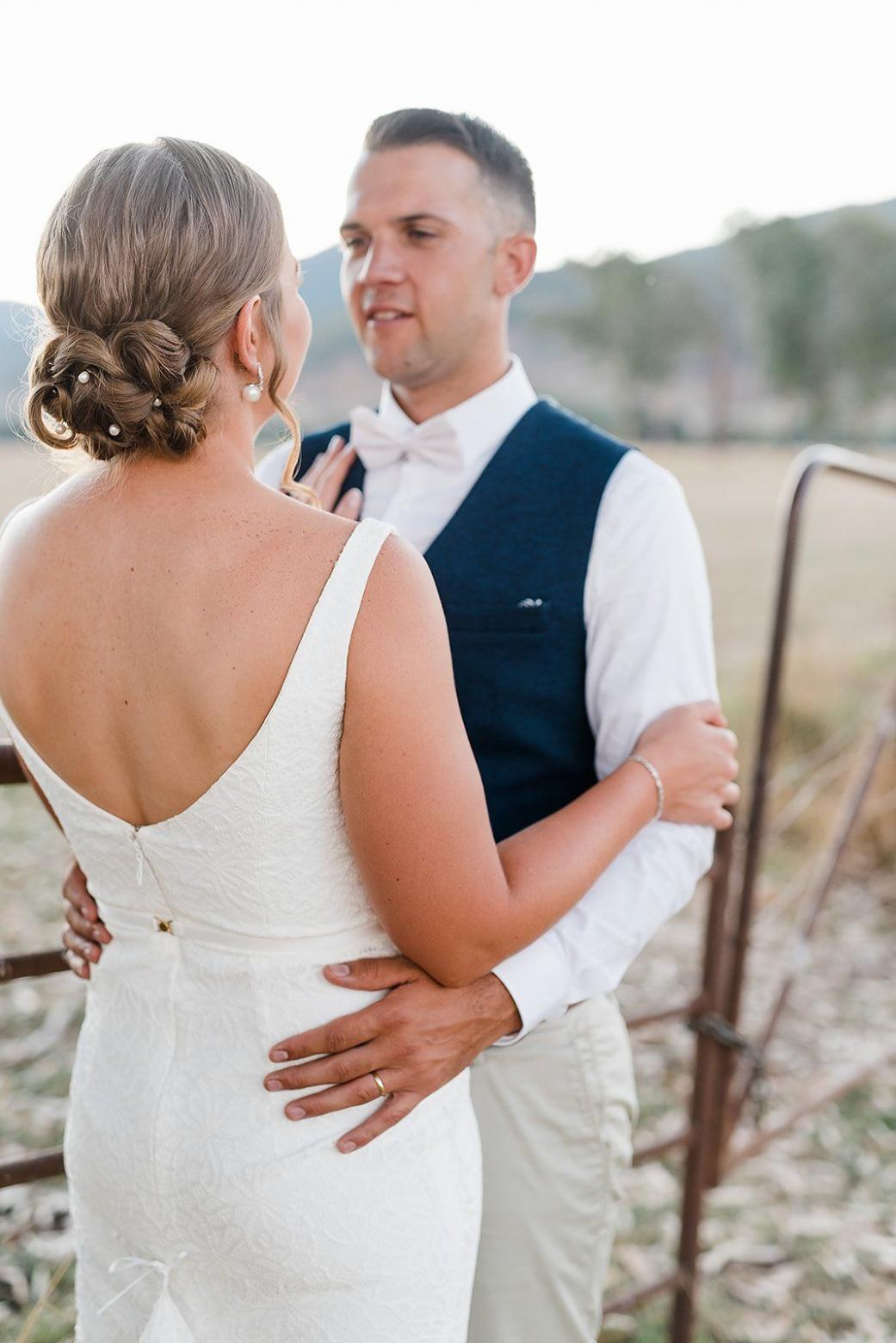 Real bride Sophie wore the Wild Hearts Rylie wedding dress by Karen Willis Holmes.