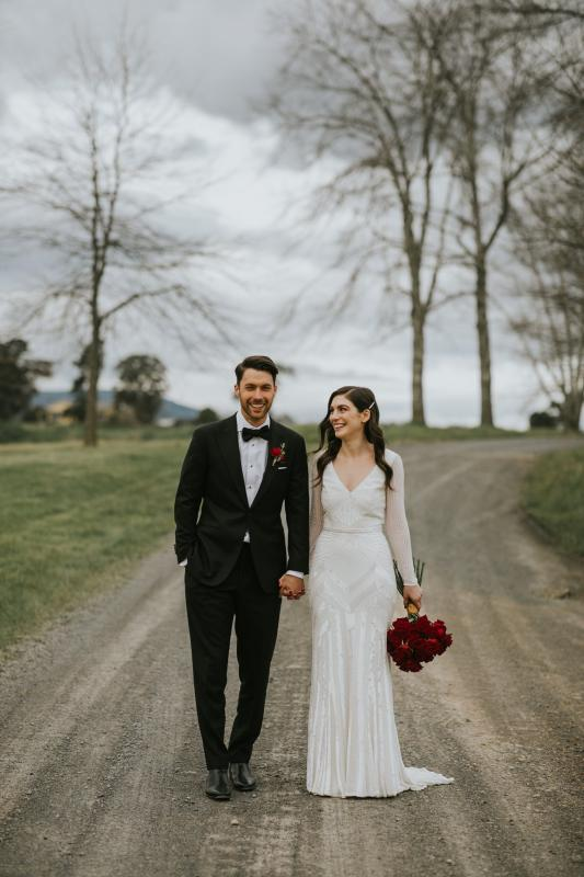 Real bride Louise wore the Luxe Cassie wedding dress by Karen Willis Holmes.