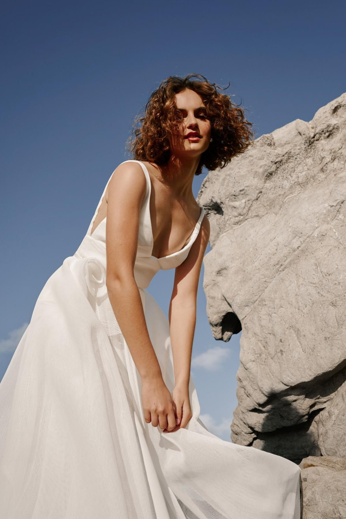 The Aisha gown by Karen Willis Holmes, v-neck wedding dress with rosette detail.