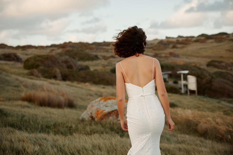 The Elodie gown by Karen Willis Holmes, a fit and flare sexy lace wedding dress with v-neck and modern feel.