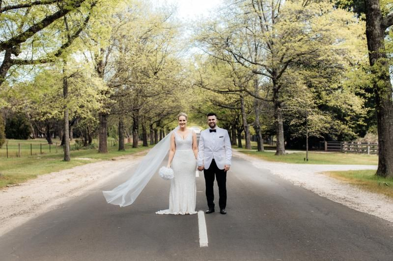 Real bride Nicole wore the Luxe Lola wedding dress by Karen Willis Holmes.