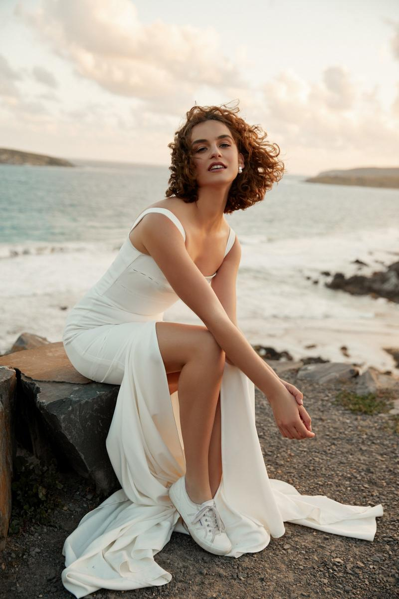 The Violet gown by Karen Willis Holmes, modern simple wedding dress with slit.