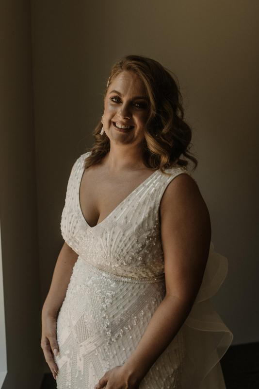 Real bride Amy wore the Luxe Fontanne wedding dress by Karen Willis Holmes.