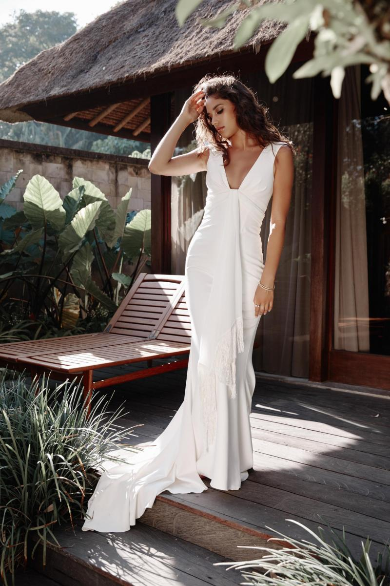 The Arabella gown by Karen Willis Holmes, plunging neckline simple sheath wedding dress.