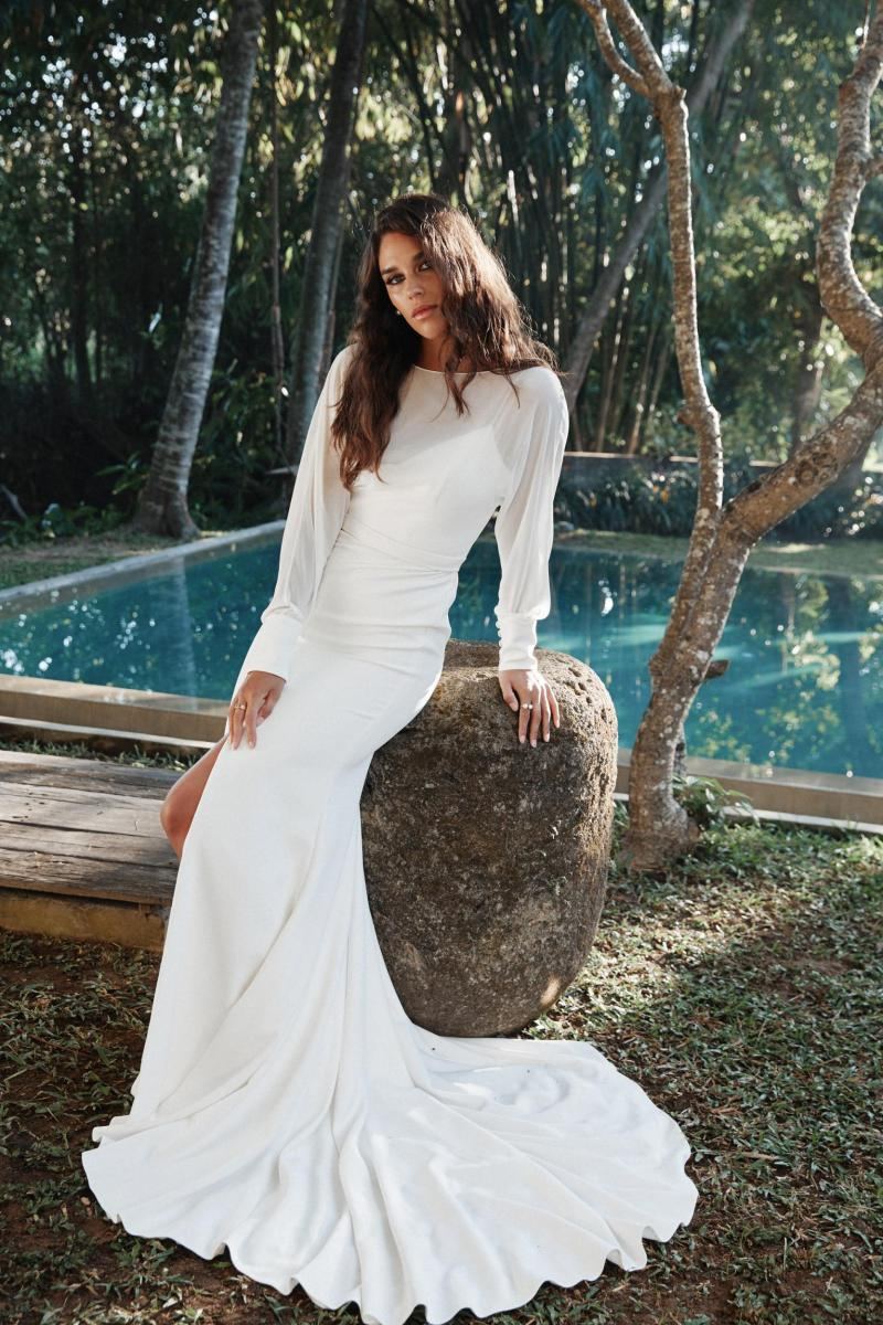 The Brie gown by Karen Willis Holmes, simple long sleeve wedding dress with slit.